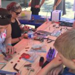 Stephanie Brohman and Trudi Starbeck-Miller demonstrate metalworking